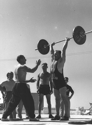 Image of weightlifters and coaches from http://wikimediafoundation.org/wiki/File:The_British_coach_giving_a_few_weight_lifting_hints.jpg