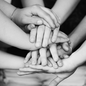 Many hands...an image shared by Nikki and Sharon McCutcheon. CC-BY.