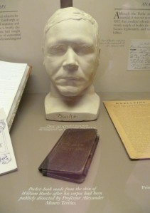 Death mask cast of William Burke and a pocket book made from his skin; Burke was executed in 1828 for murdering people and delivering their bodies to medical school in Edinburgh.